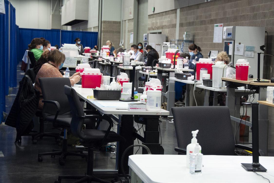 Workers mixing vaccines