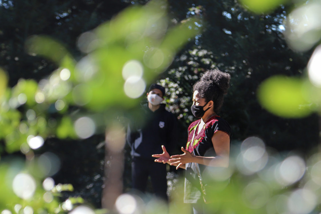 A Metro educator wearing a mask addresses a group of people at Scouters Mountain Nature Park