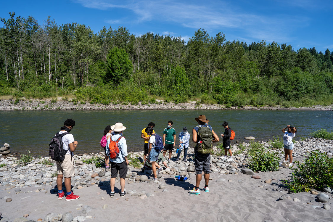 A group of training staff from Metro gather along the banks of the Sandy River in Oxbow Regional Park