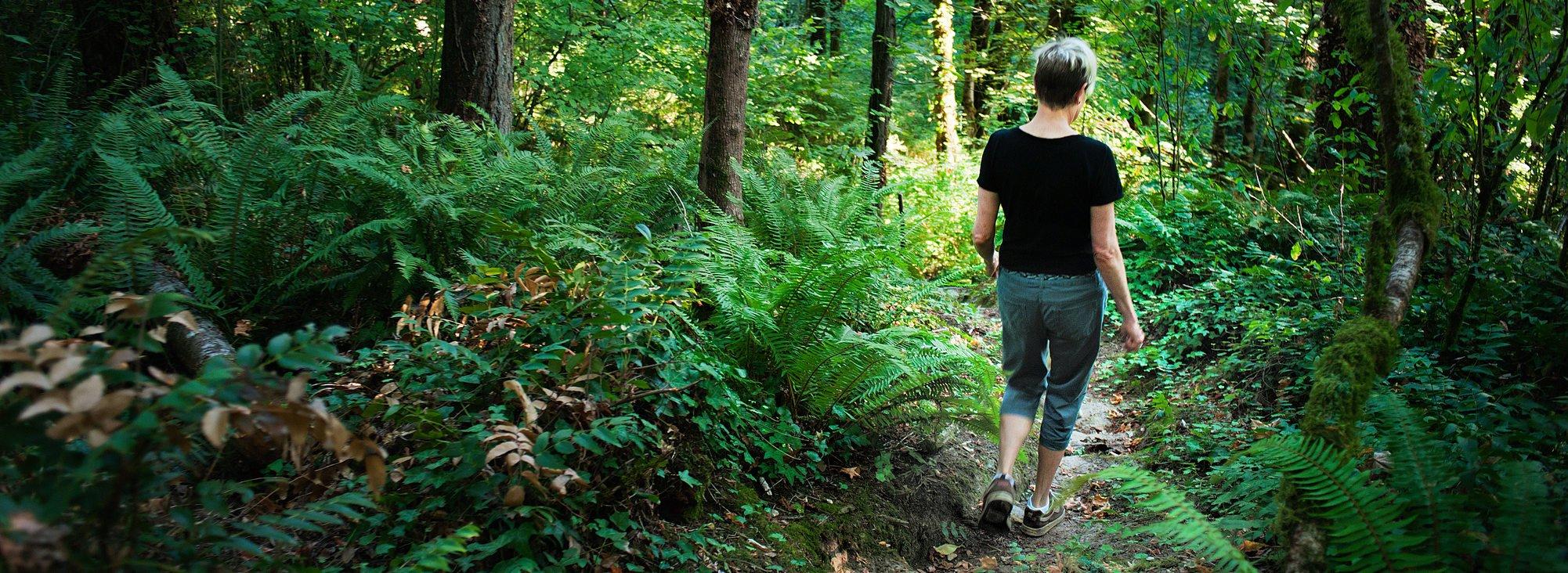photo of woman walking at Newell Creek Canyon