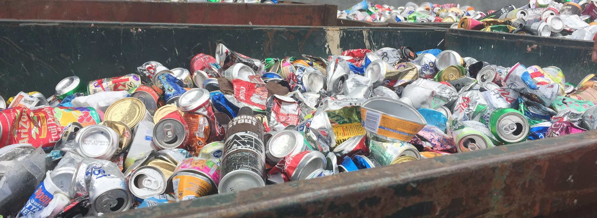 photo of aluminum cans in recycling bin