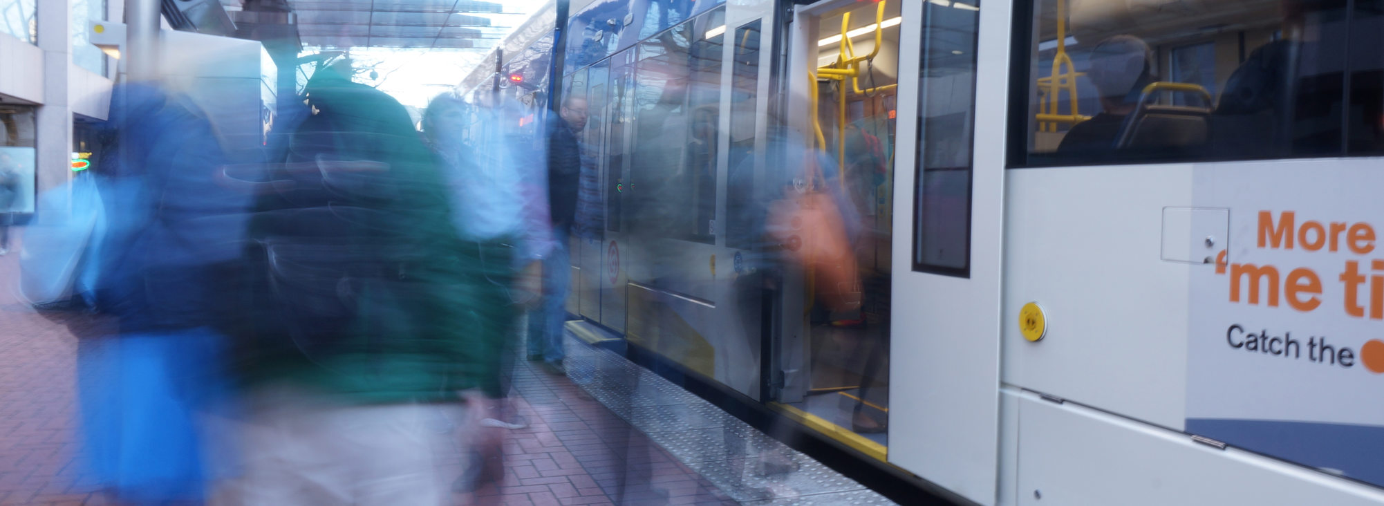 Blurry photo of people getting on light rail