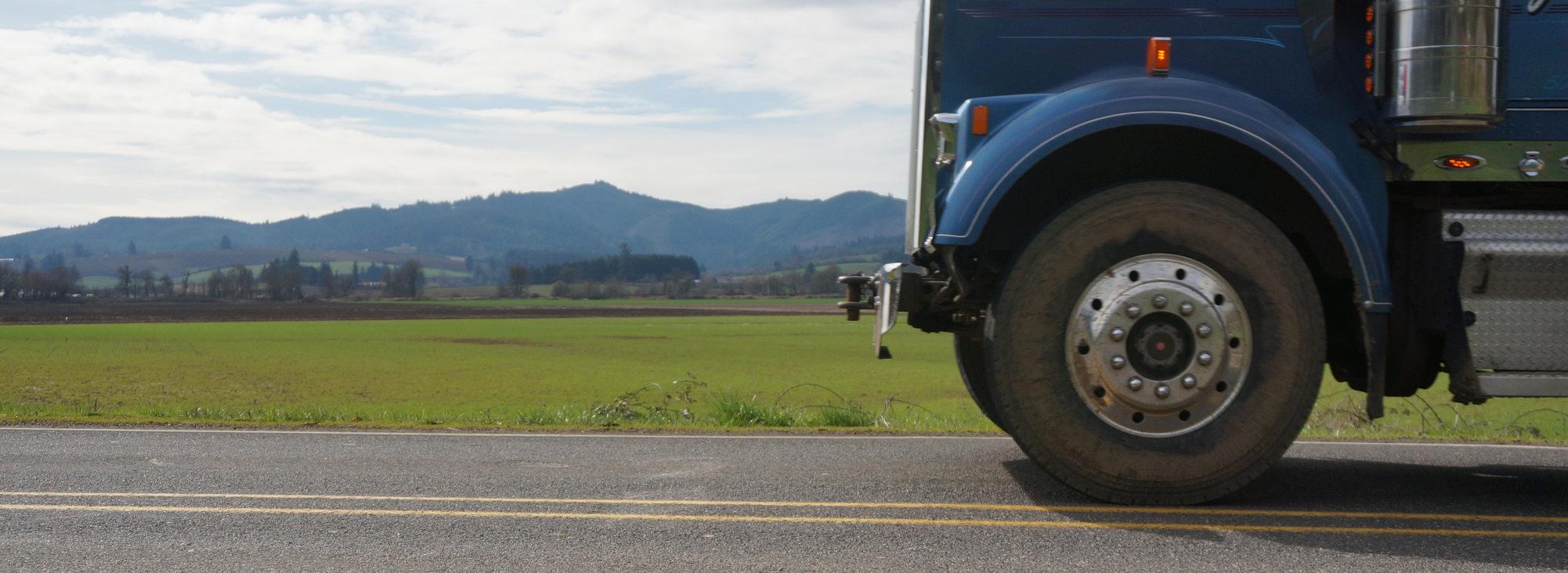 Wide shot of a freight truck wheel