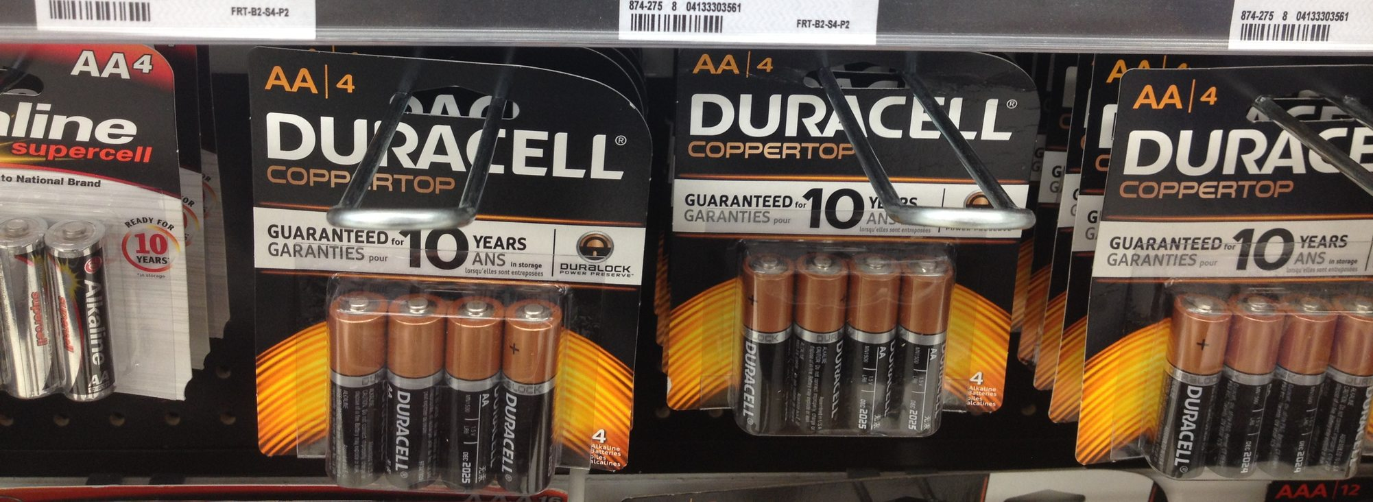 batteries on display racks in a store