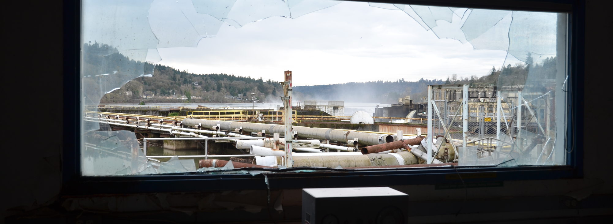 A broken window overlooking Willamette Falls.
