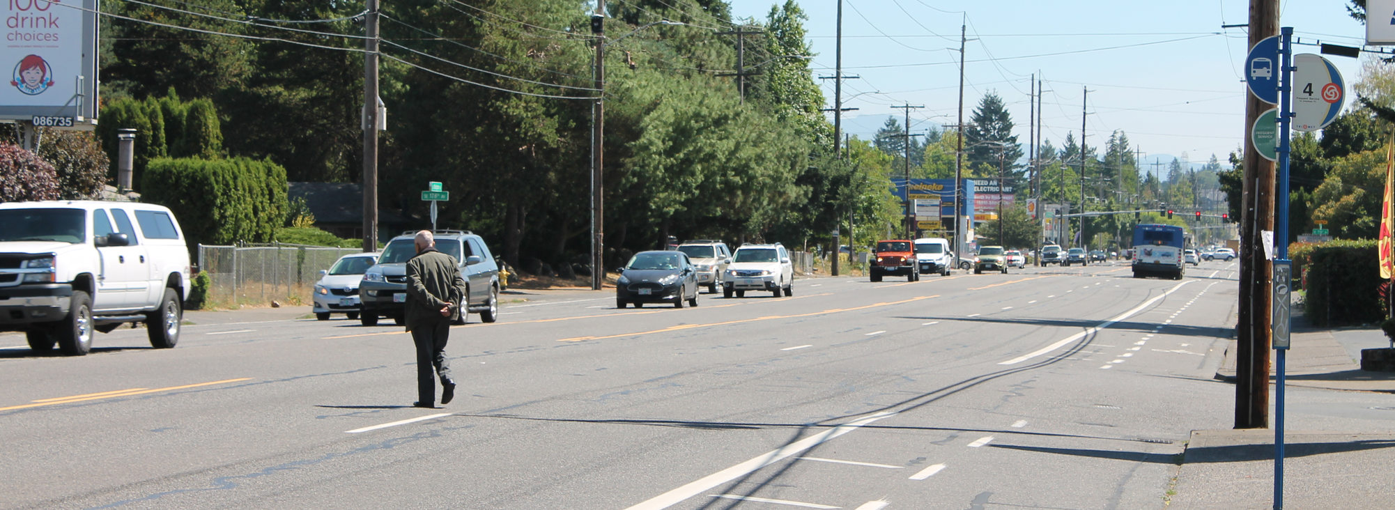 Man crossing wide Division Street in Gresham
