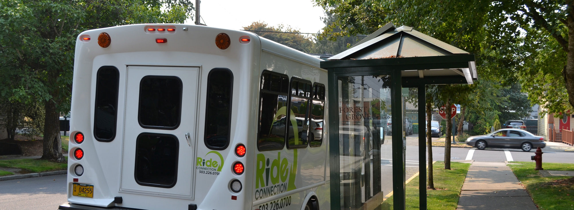 A Ride Connection bus at a bus stop in Forest Grove