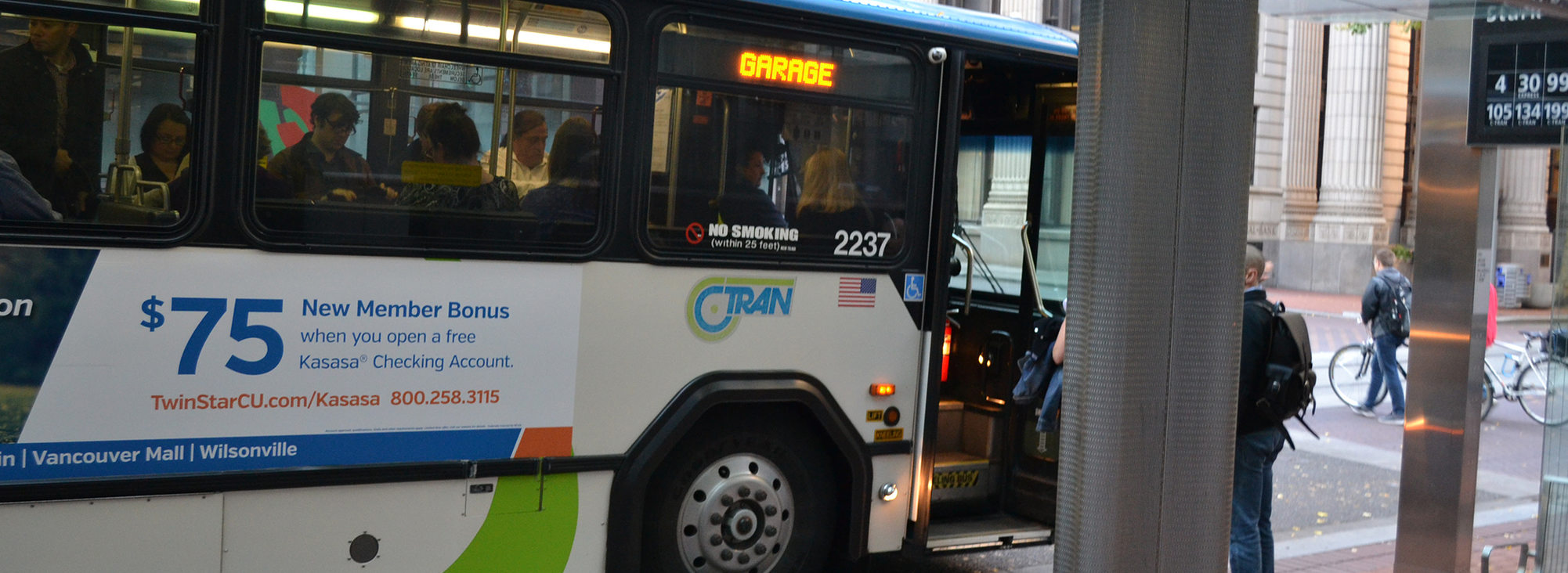 people boarding a C-TRAN bus at a bus stop in downtown Portland