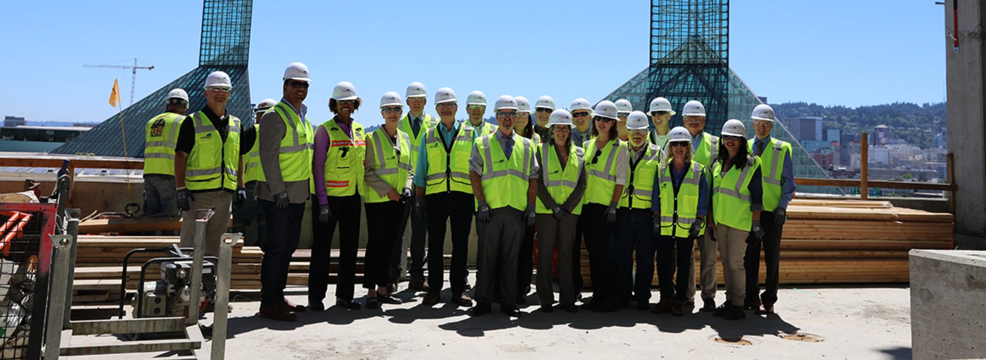 group of people in hard hats being led on a construction tour of the Hyatt Hotel at Oregon Convention Center