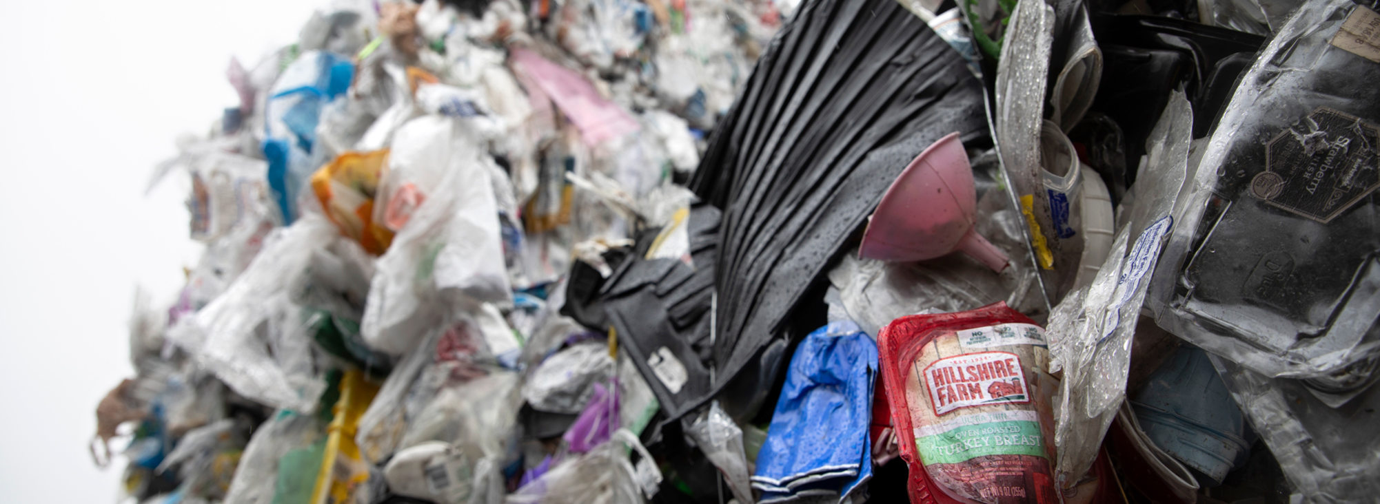 Close up of large bales of plastics items that are not recyclable