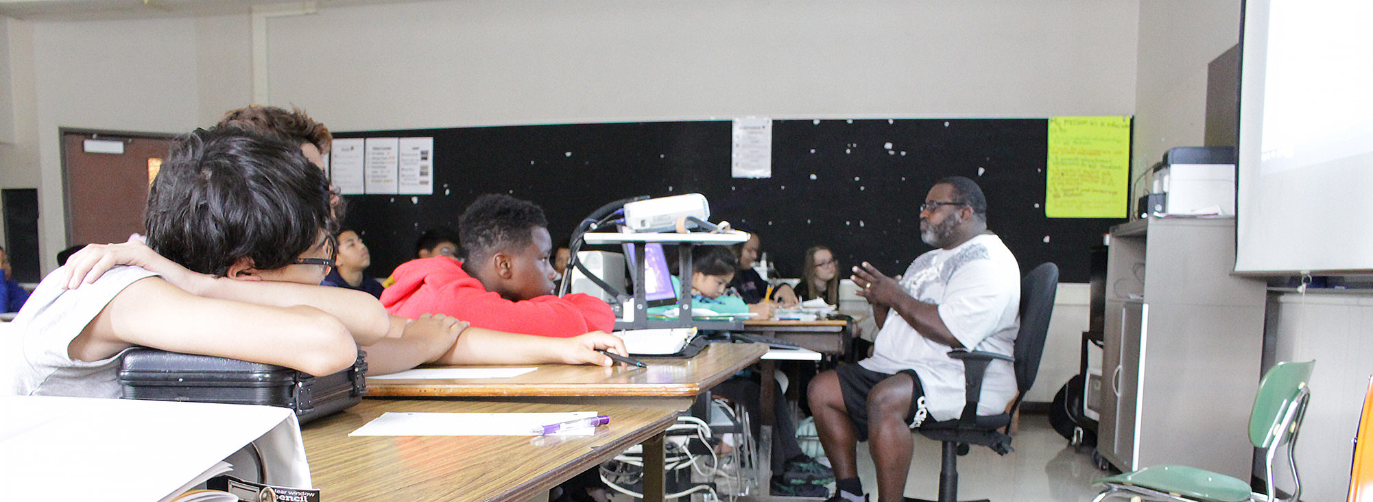 middle school students give their attention to their teacher during health class