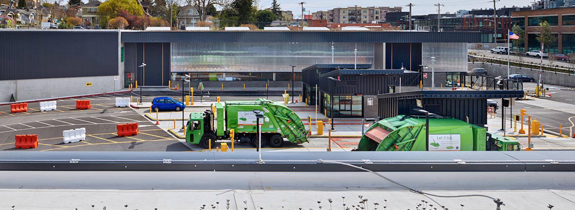 Garbage trucks dump their loads at the North Transfer Station in Seattle