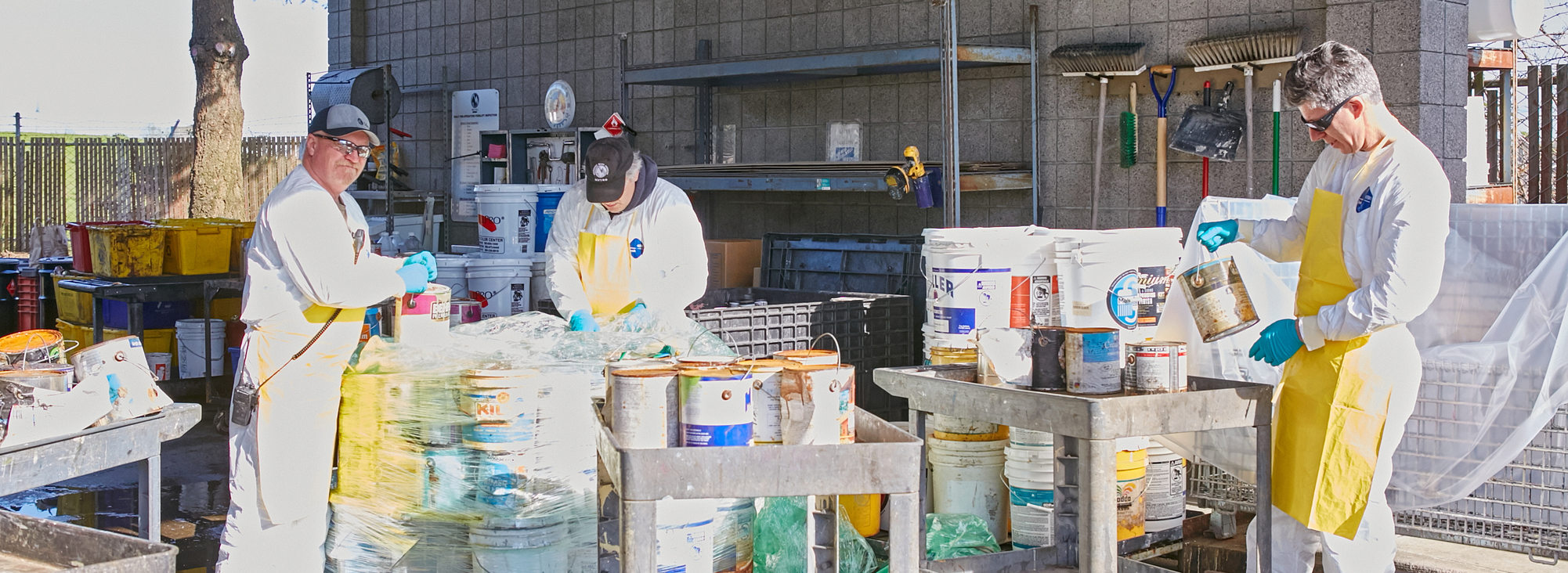 staff at Metro Central Household Hazardous Waste sort through items dropped off for safe disposal