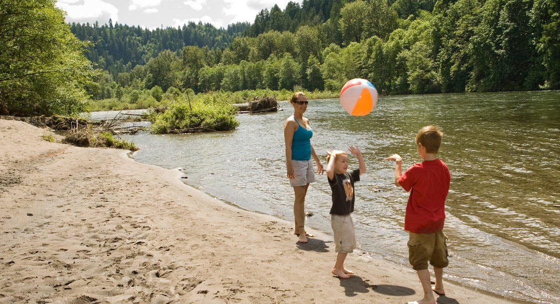 Children playing by the river at Oxbow Park