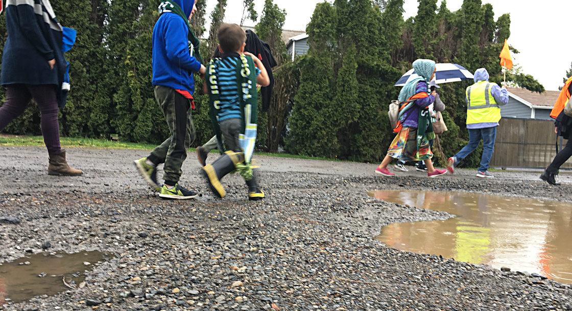 Schoolkids on an unpaved street