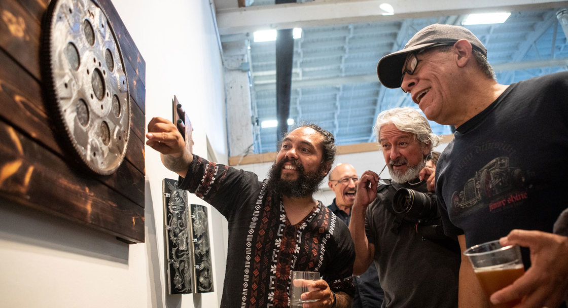 Artist Cruz Torres talks about his work with event attendees