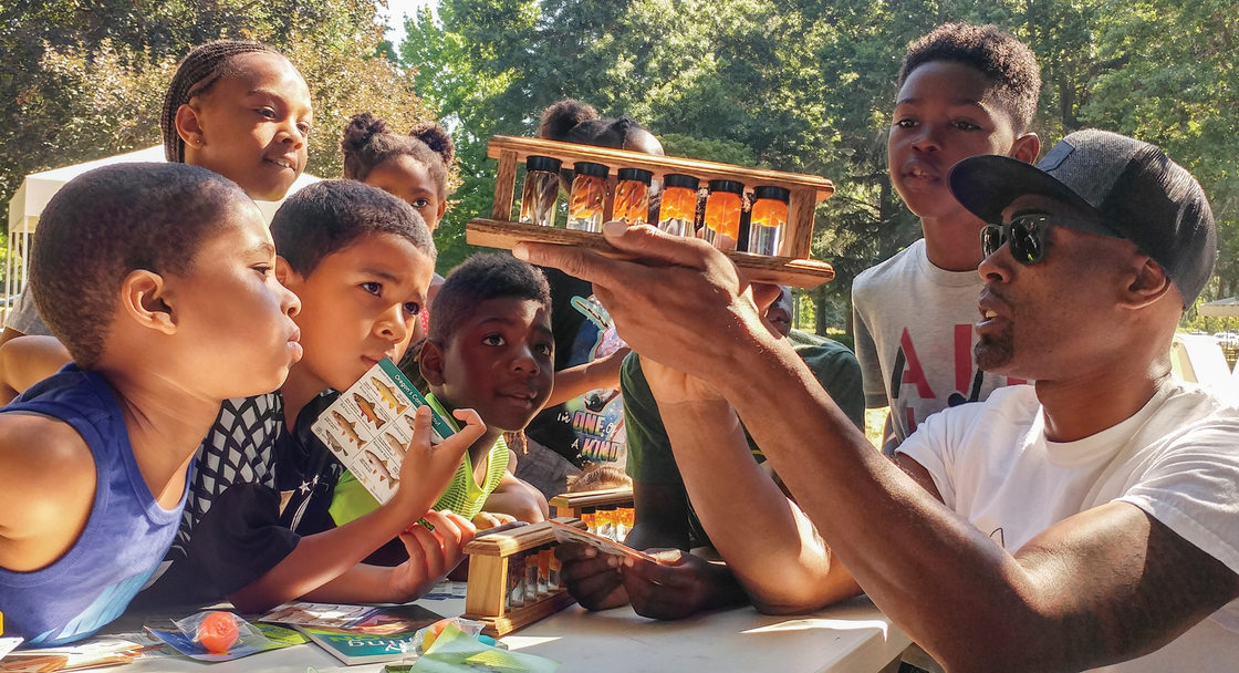 Dishaun Berry of Get Hooked teaches campers from Camp ELSO about the life stages of fish at Blue Lake Regional Park.