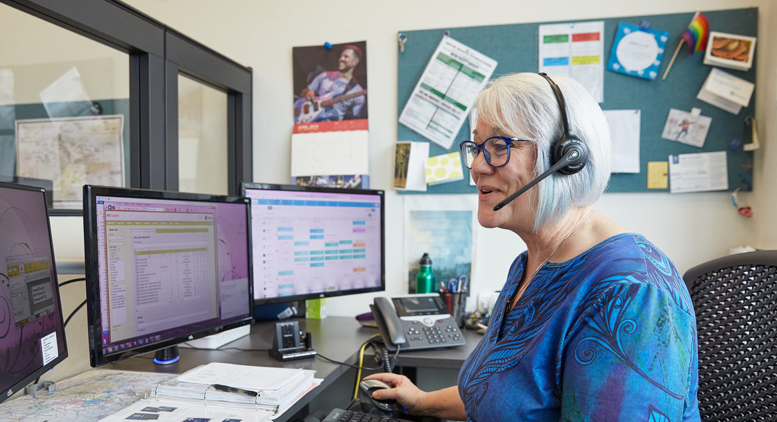 recycling expert on the phone at her desk