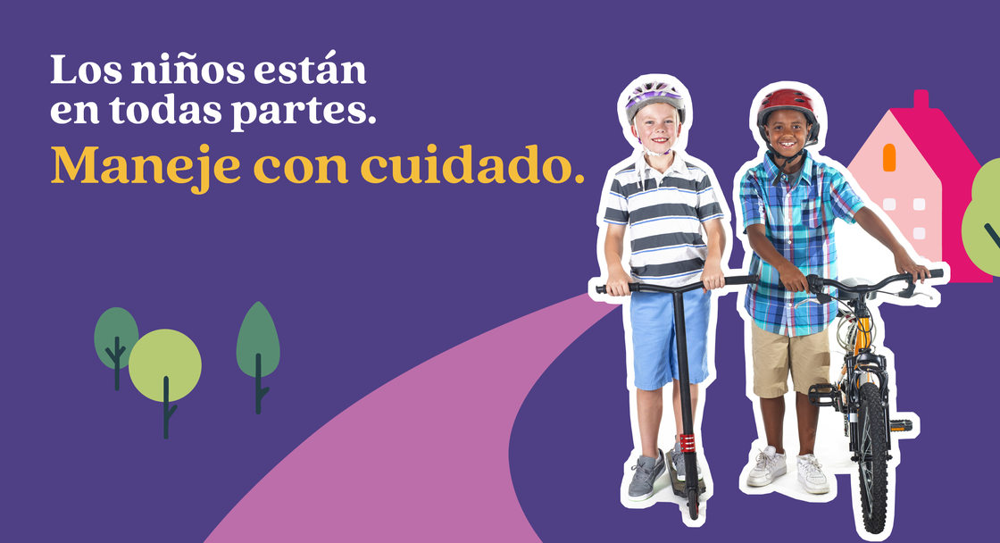 "Safety campaign poster in Spanish for Safe Routes to School showing one child on a bike with another child on a scooter. The text on the image say ""Kids are everywhere. Drive like it"" translated into Spanish"