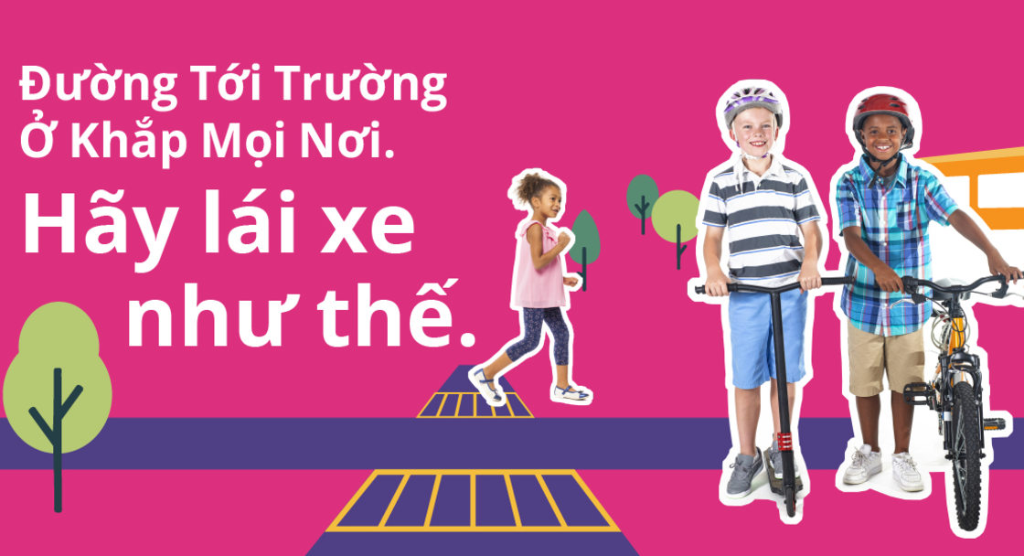 """Safety campaign poster with text saying """"School routes are everywhere. Drive like it"""" in Vietnamese. Two children are standing with bikes and scooters with an animated background"""