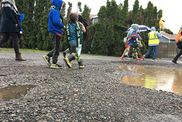 Schoolkids on an unpaved street