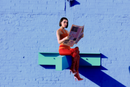 artistic image of Annie Clark from Saint Vincent reading a newspaper