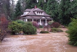photo of Stout-Schacht house inundated with Johnson Creek floodwaters