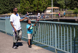 Father and son fishing at Blue Lake Regional Park