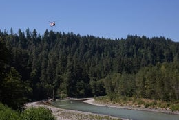 Helicopter delivers large logs alongside the Sandy River at Oxbow Regional Park