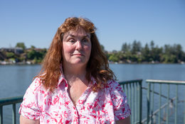 Patricia Kepler on the fishing dock at Blue Lake Regional Park