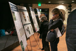 Woman reading display board at Gabbert Butte Nature Park open house in Gresham