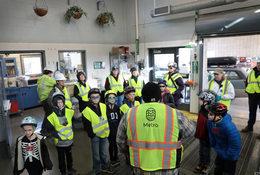 a group of kids steps inside a hazardous waste facility