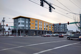 the view of a new apartment building from the corner of SE 82nd Avenue and Division Street