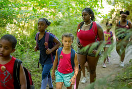 Children taking part in Camp ELSO's 2018 summer camp walk through the ancient forest at Oxbow Regional Park.Camp ELSO was awarded $100,000 for its Young Black Environmentalists Internship Program.