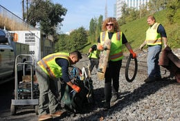 RID Patrol members clean up trash along Sullivan's Gulch